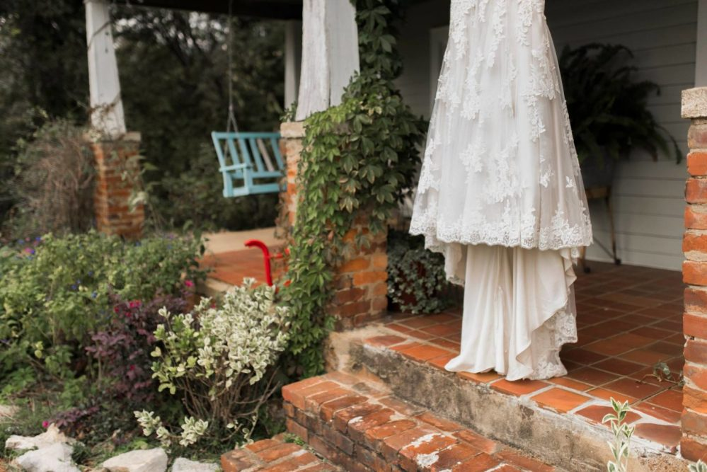 bridal gown hanging from farmhouse porch