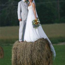 bride and groom on haybale