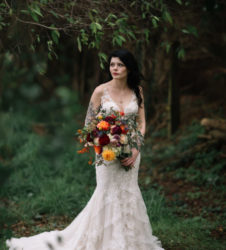 Bohemian bride in tree tunnel